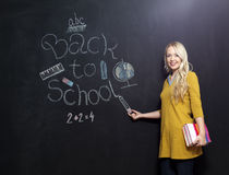 Back to school woman teacher smiling by blackboard Royalty Free Stock Photography