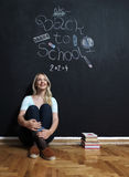 Back to school woman teacher smiling by blackboard Royalty Free Stock Photos