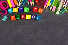 Back to School wooden blocks with school supplies border on blackboard Royalty Free Stock Photography
