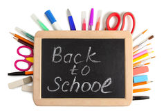Back to school. Wooden plaque with the inscription `back to school` near stationery on a white isolated background Stock Photo
