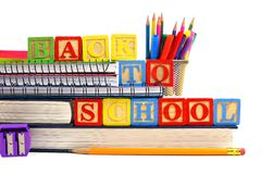 Back to School wooden toy blocks on books with school supplies Royalty Free Stock Photography