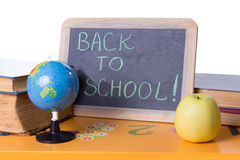 Back to school word on board, books and globe Stock Photos
