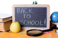Back to school word on board, books and globe Royalty Free Stock Photography