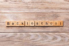 Back To School word written on wood block. Back To School text on wooden table for your desing, concept royalty free stock images