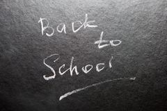 Back to school - words on blackboard with chalk royalty free stock photo
