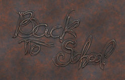 Back to school words lettering on corroded brass metal background.  stock illustration