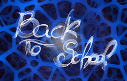 Back to school words lettering made by white fire or flame over abstract sponge background.  Stock Photography