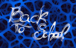Back to school words lettering made by white fire or flame over abstract sponge background.  Royalty Free Stock Image