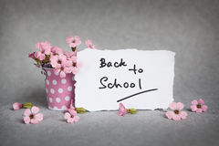 Back to school, words with pink flowers Stock Image