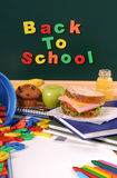 Back to school words text on classroom blackboard with packed lunch Stock Photo