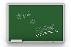 Back to school writing on blac. Kboard Royalty Free Stock Image