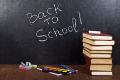 Back to school written. On chalkboard witch books Stock Photography