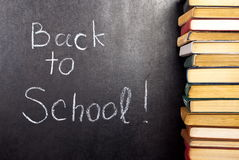 Back to school written. On chalkboard witch books Royalty Free Stock Images