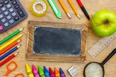 Back to School written on a blackboard Royalty Free Stock Image