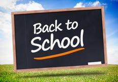 Back to school written on blackboard Stock Images