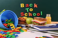 Back to school written on blackboard, desk, classroom Stock Image