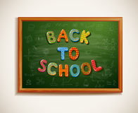 Back to school written on blackboard Stock Images