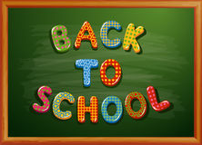 Back to school written on blackboard Stock Photos