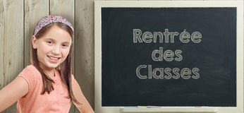Back to school written on  blackboard with  young girl Royalty Free Stock Photo