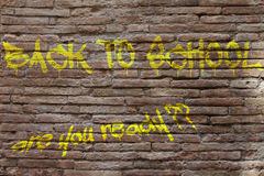 Back to school written on a brick wall Stock Photography