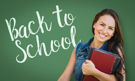 Back To School Written On Chalk Board Behind Mixed Race Teen Royalty Free Stock Photo