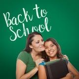Back To School Written On Chalk Board Behind Proud Hispanic Moth stock photography