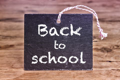 Back To School written on chalk board. The words BackTo School written on chalkboard on wooden table Royalty Free Stock Images