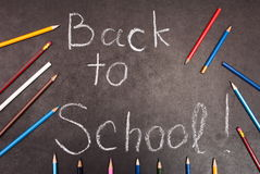 Back to school written on chalkboard. With pencils Stock Image