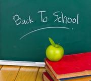 Back to school written on chalkboard. Stock Photo