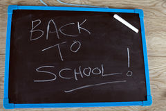 Back to school written on a chalkboard Royalty Free Stock Image