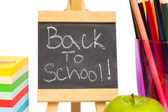 Back to school written on chalkboard. On white background Royalty Free Stock Photo