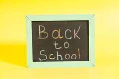 Back to School written on a chalkboard Royalty Free Stock Photography