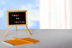 Back to school written with colorful letters on blackboard, and stock photography