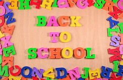 Back to school written by colorful letters on a wooden backgroun Stock Image