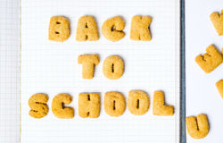 Back to school written with cookies. On a notebook Stock Images
