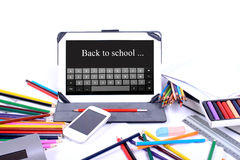 Back to school written on a digital tablet Royalty Free Stock Image