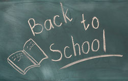 Back to school written on green Stock Photo