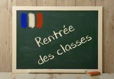 Back to school written on green blackboard Royalty Free Stock Photo