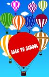 BACK TO SCHOOL written on hot air balloon with a blue sky background. Illustration Stock Image