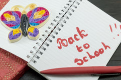 Back to school written on a notebook Stock Photo