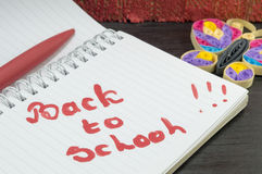 Back to school written on a notebook Royalty Free Stock Image