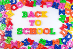 Back to school written by plastic colorful letters on a white Royalty Free Stock Photography