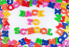 Back to school written by plastic colorful letters on a white Royalty Free Stock Images