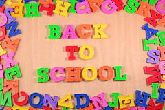 Back to school written by plastic colorful letters Royalty Free Stock Photos