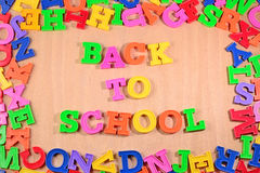 Back to school written by plastic colorful letters Stock Images
