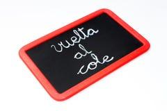 Back to school written in Spanish in a blackboard Stock Photography