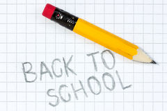Back to school written on a squared paper. With pencil Stock Images