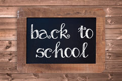 Back to school written on a vintage blackboard Royalty Free Stock Photography