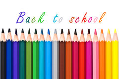 Back to school written on white background with colorful pencils Royalty Free Stock Image