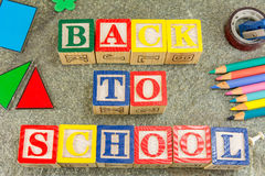 Back to school written with wooden cubical letters Royalty Free Stock Photos